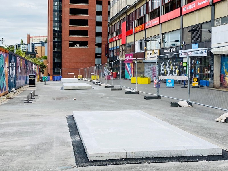 Concrete skate park ramps on street