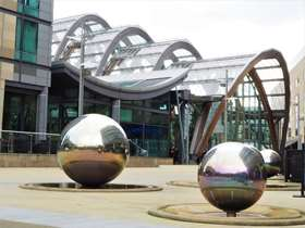 Silver sphere fountain sculptures