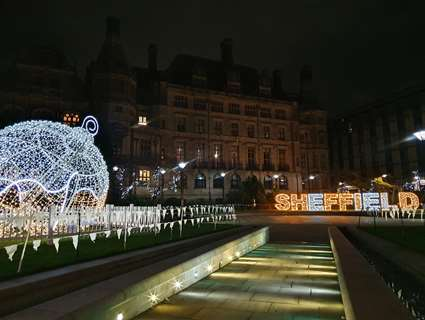 Large Christmas bauble lit up in Sheffield Peace Gardens