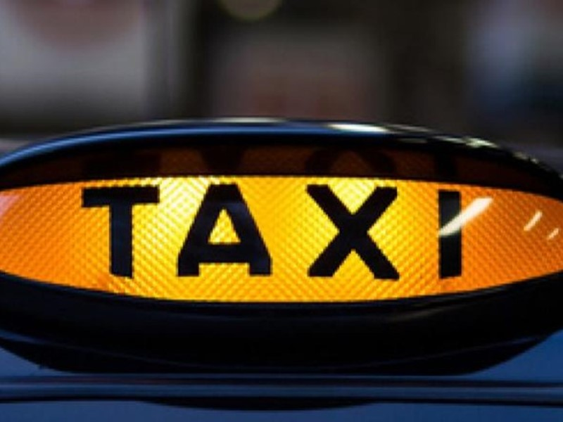 Taxi sign lit up
