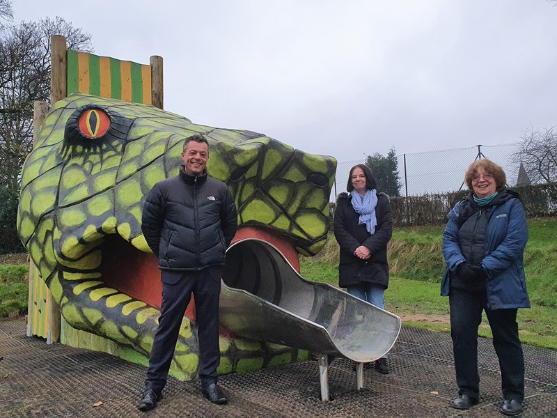 Councillor Bob Johnson, Councillor Mary Lea and Christine Welburn stand next to snake head slide at Hillsborough playground