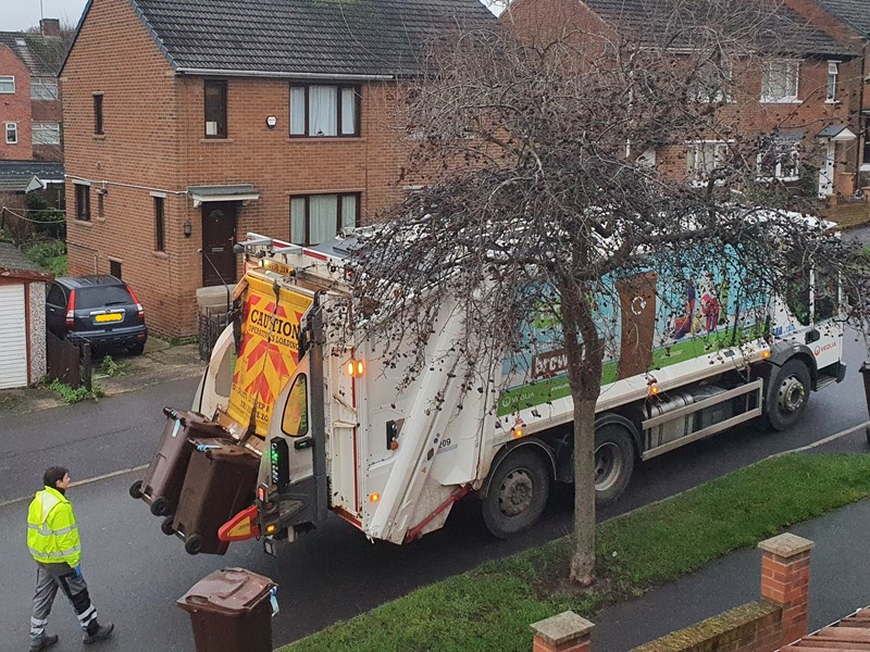 Bins being emptied in to a bin lorry