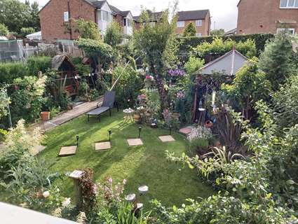 Award-winning green garden with paved footpath