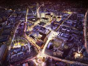 Drone shot of Sheffield city centre lit up at night