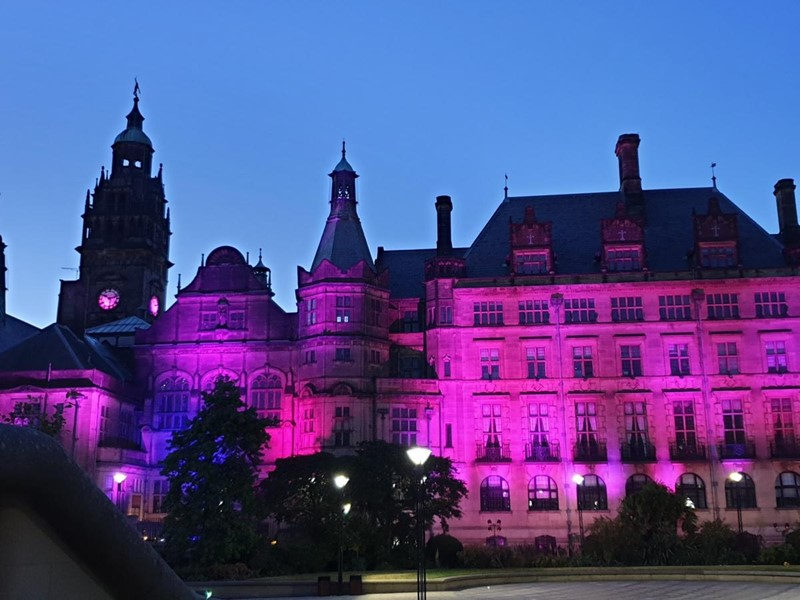 Sheffield Town Hall lit in purple at night