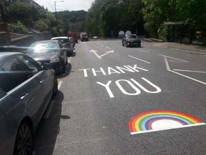 Thank you and rainbow painted on road outside hospital