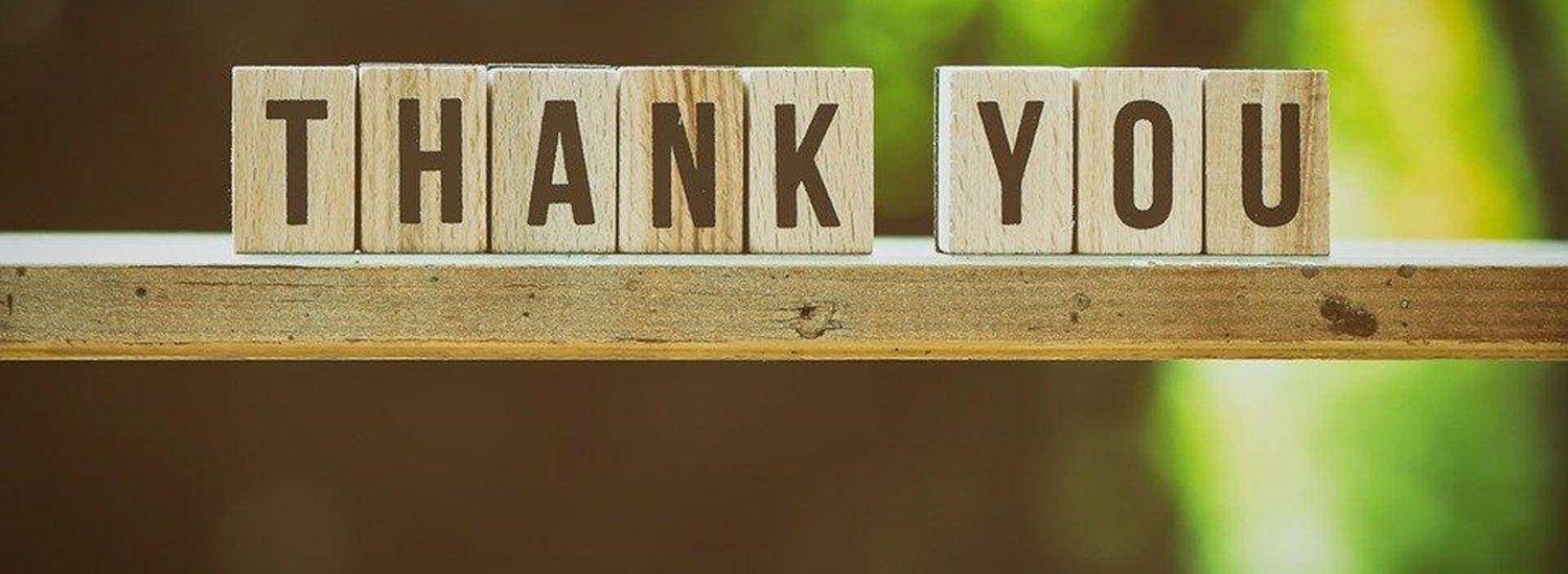 Thank you in wooden block letters