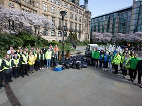 Group of people in Sheffield Peace Gardens ready to spring clean