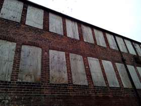 Boarded up windows at Leah's Yard