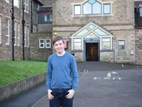 Lewis outside Thomas Rotherham College
