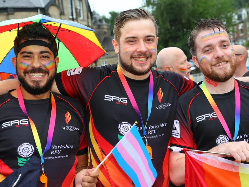 3 men at a Pride event