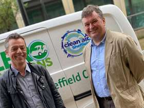 Bob Johnson and Mark Jones in front of electric van