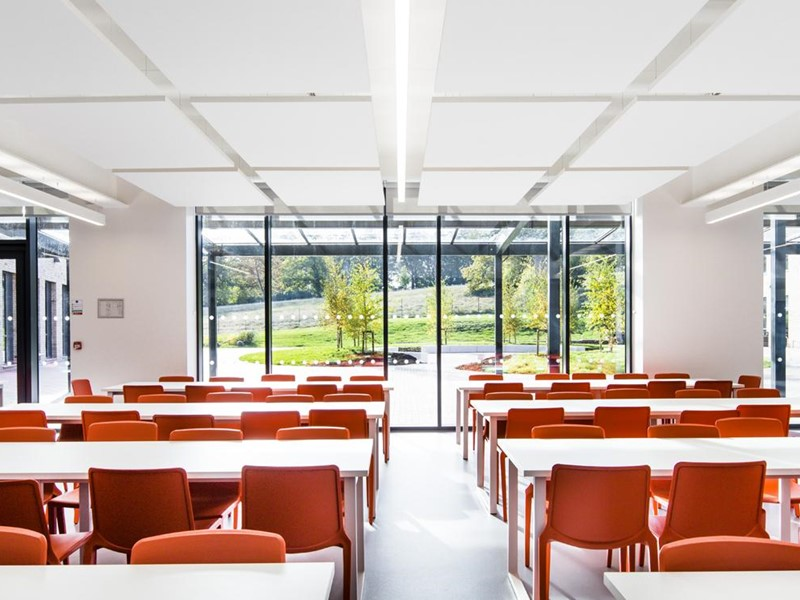 A classroom with seats facing a window