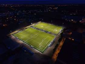 Football pitch from above lit at night